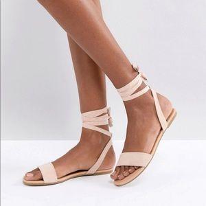 Lace up sandal flats.